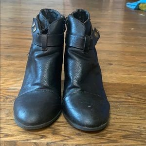 Black ankle boot with a side buckle